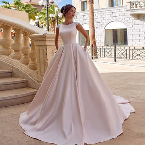 Best France Satin A-line Wedding Dresses Robe Mariage Femme Beading Appliques Buttons Up Princess Bride Gowns With Pockets