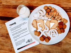 A letter to Santa outlining threats on Anteefa Global letterhead, next to a glass of milk and a plate of cookies in various shapes including hammer and sickle, anarchy A, dicks, 1312, etcetera.
