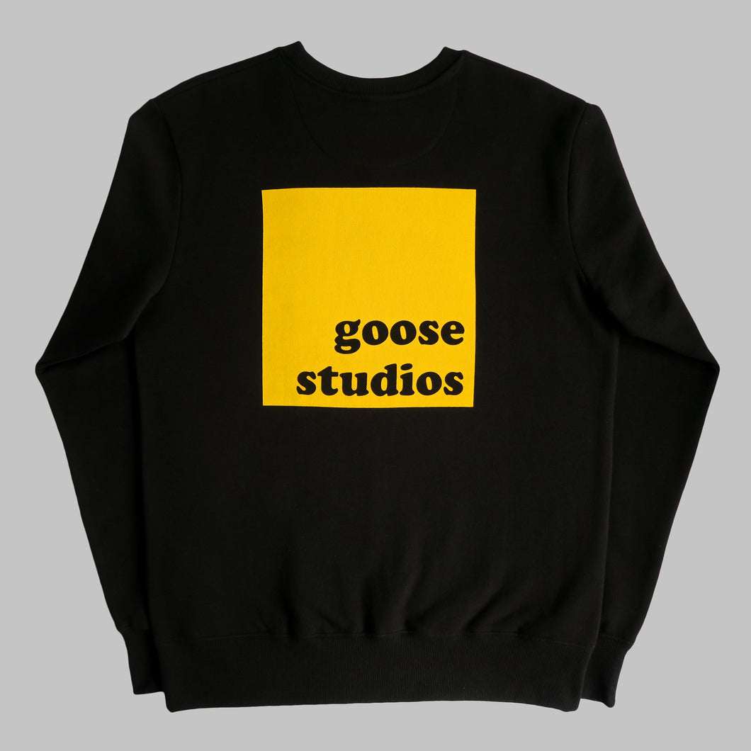 Back of Black organic cotton sweatshirt with yellow printed logo