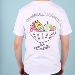 Back view of a man wearing a white organic cotton t-shirt with multi-coloured fruit bowl print