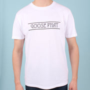 Front view of a man wearing a white organic cotton t-shirt with black printed text logo
