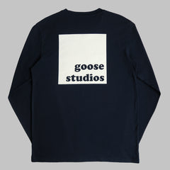Back of Navy blue organic cotton long sleeve T Shirt with white printed logo