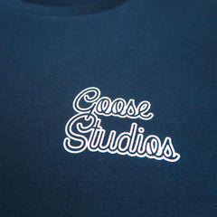 Close up of front of Navy blue organic cotton long sleeve T Shirt with white printed logo