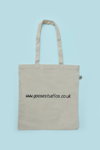Back of printed organic cotton tote bag with black text