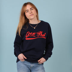 Front view of a woman wearing a Navy organic cotton sweatshirt with Red printed logo