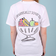 Back view of a woman wearing a white organic cotton t-shirt with multi-coloured fruit bowl print