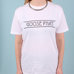 Front view of a woman wearing a white organic cotton t-shirt with black printed text logo