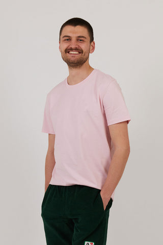 Man wearing pink organic cotton t shirt