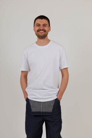Man wearing white organic cotton t shirt