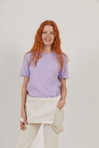 Woman wearing lilac organic cotton sustainable t-shirt