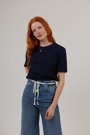 Woman wearing navy organic cotton sustainable t-shirt