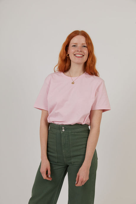 Woman wearing organic cotton pink sustainable t-shirt