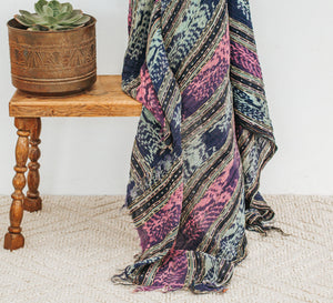 Boho patterned tassled throw in blue