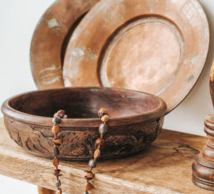 Vintage handcarved wooden bowl with african animals on the outside