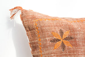 Boho rust coloured embroidered linen cushion with tassles
