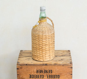 Vintage boho cane covered Bacardi Rum Bottle