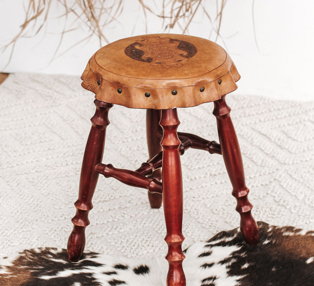 Vintage boho wooden stool with carved leather top
