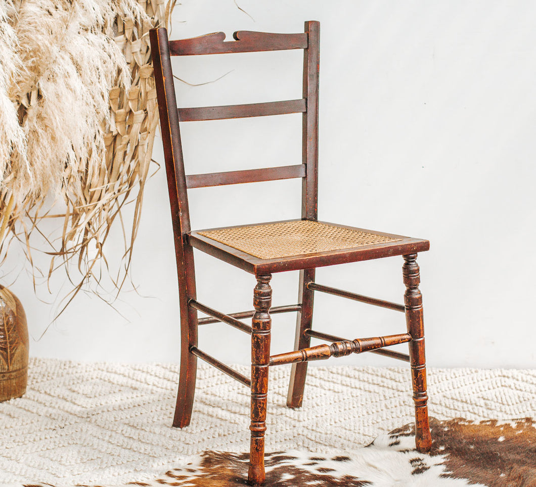 Vintage boho wooden dining chair with rattan seat