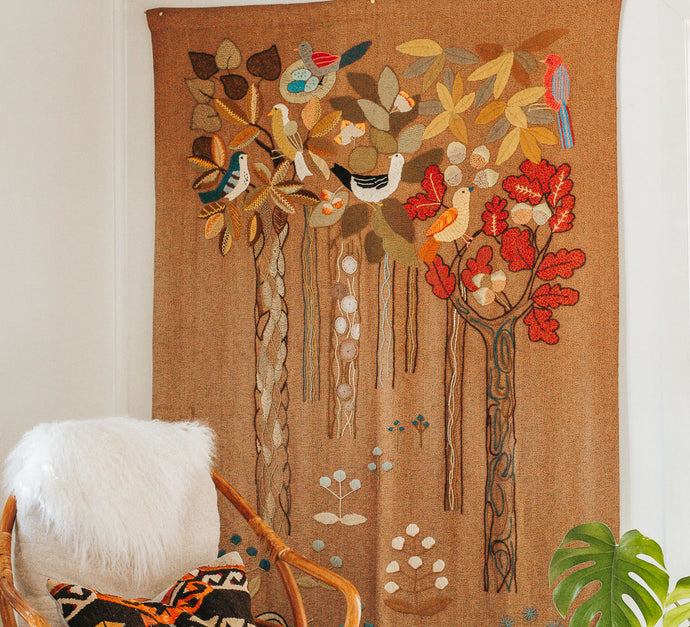 Vintage woven wallhanging with bright coloured birds in trees embroidery