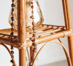 Tan Moroccan leather pouf with brown embroidery and stitching