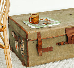 Vintage green canvas and leather travel trunk