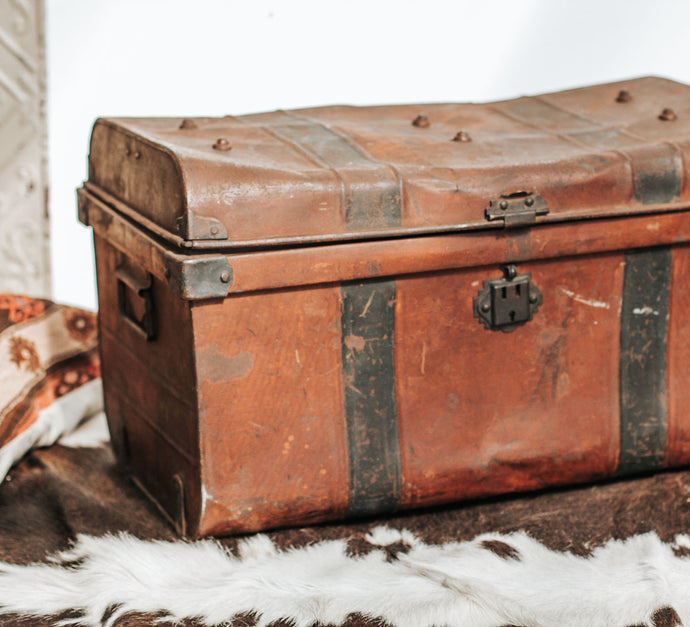 Vintage rust coloured tin travel trunk