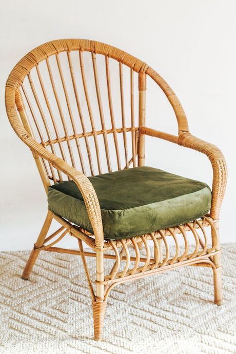 Boho Vintage cane armchair with green velvet cushion