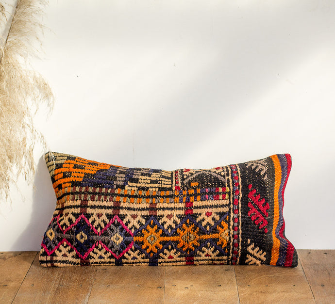 Boho kilim cushion with tangerine, pink and midnight blue colours