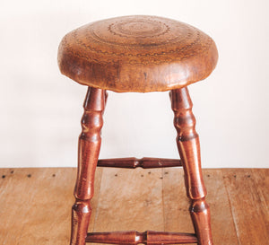 Vintage wooden stools with leather carved seat