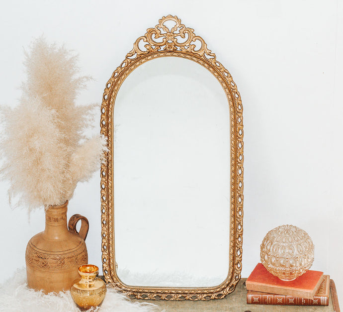 Vintage ornate gold gilded oval shaped mirror