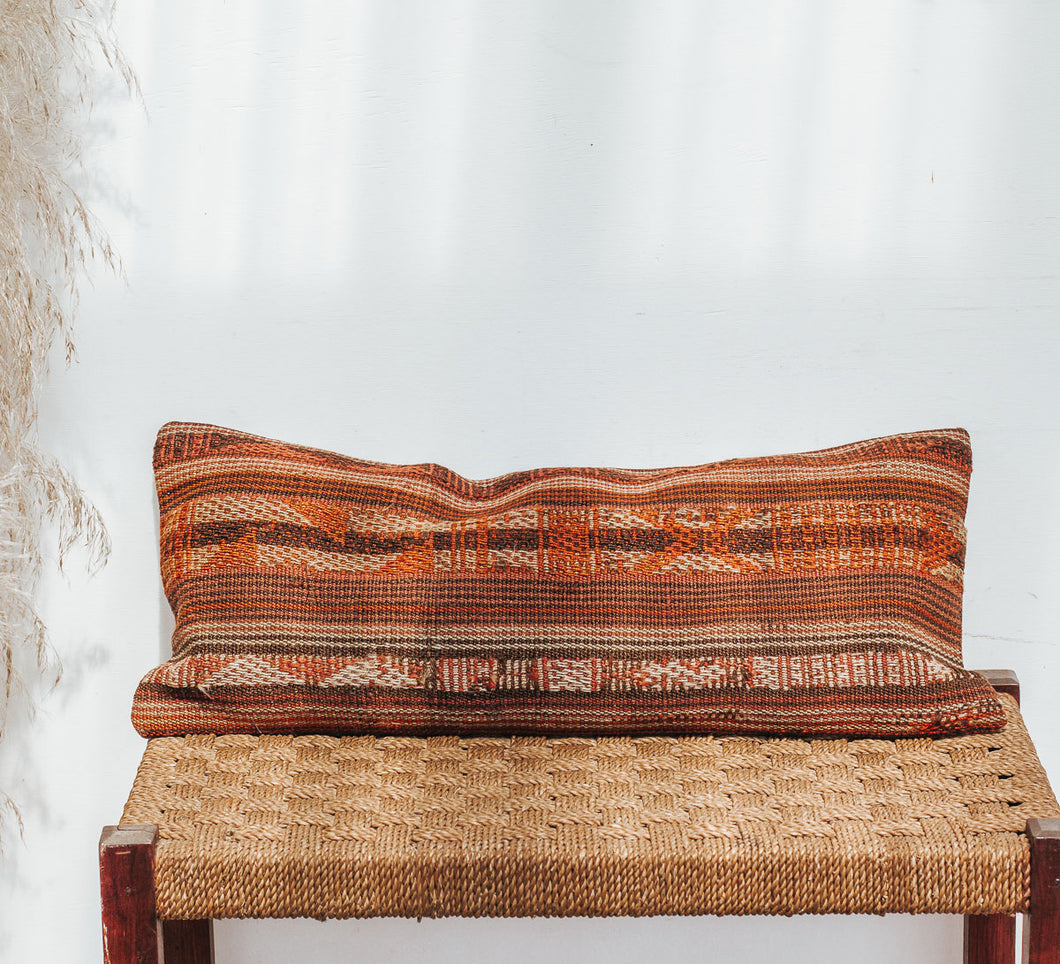 Vintage boho kilim cushion with orange and red stripes
