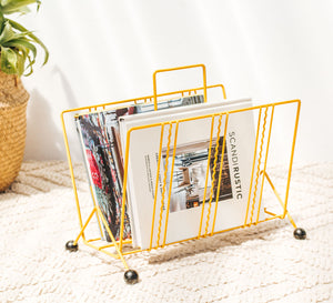 Yellow Vintage retro steel wire magazine rack with black round ball feet