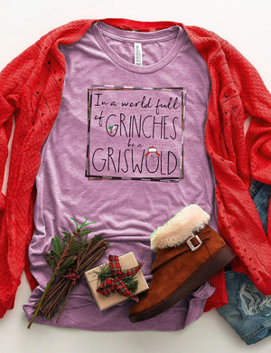 In A World Full Of Grinches Be A Griswold Tee In Purple