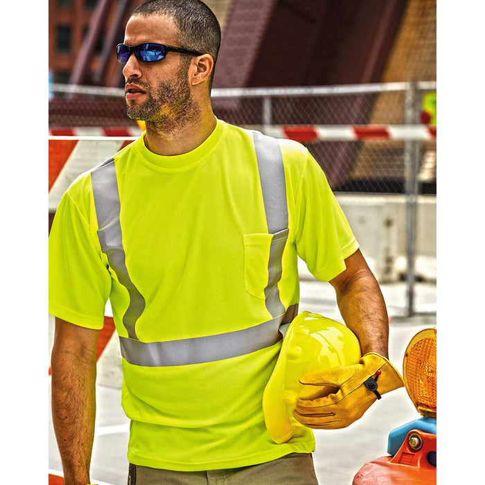 Contractor on job site with high visibility t-shirt and reflective stripes