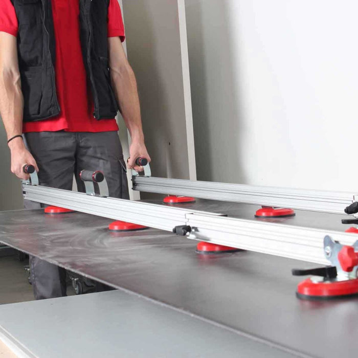 Rubi Slim Easytrans Thin Panel Transport Kit uses suction cups mounted to rails to move large thin panel tile with ease