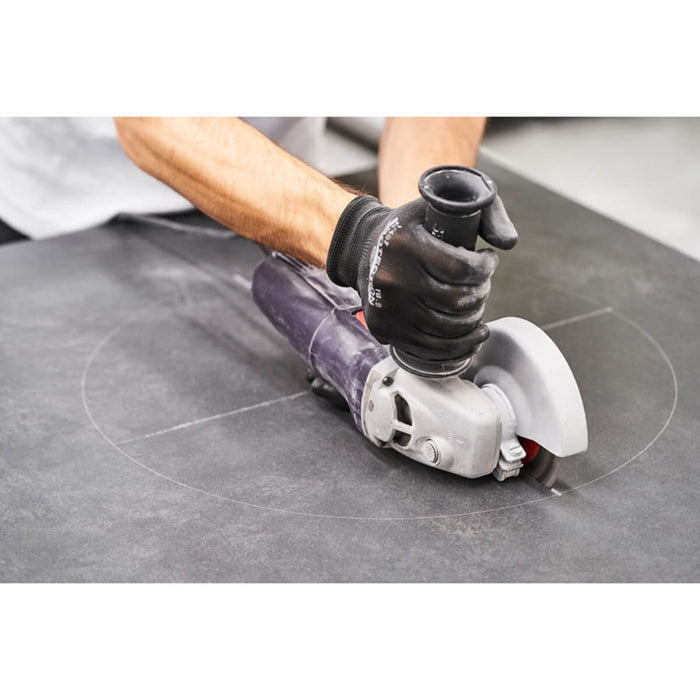 Angle grinder to cut cloves into porcelain sheets for circular cut-outs
