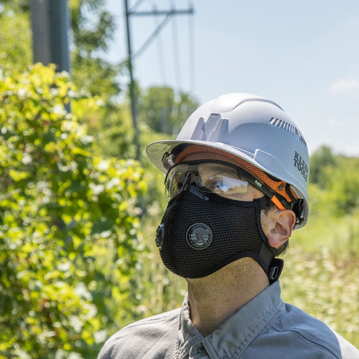 Man wearing Klein Tools Reusable Face Mask with hard hat and glasses