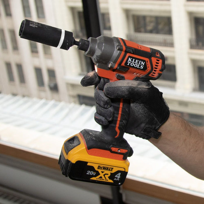 Contractor holding Klein Tools Impact driver with 2-in-1 socket attached