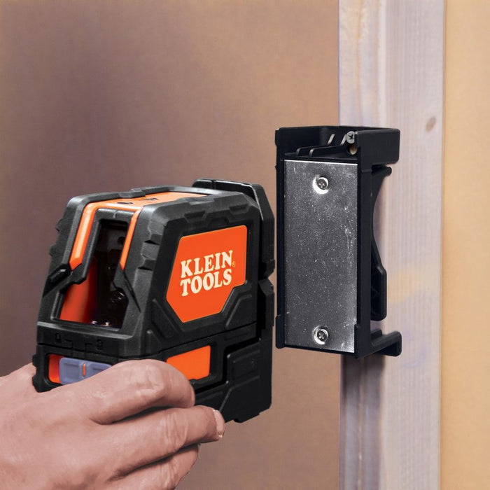 Removing Klein laser level from mounted magnetic wall bracket