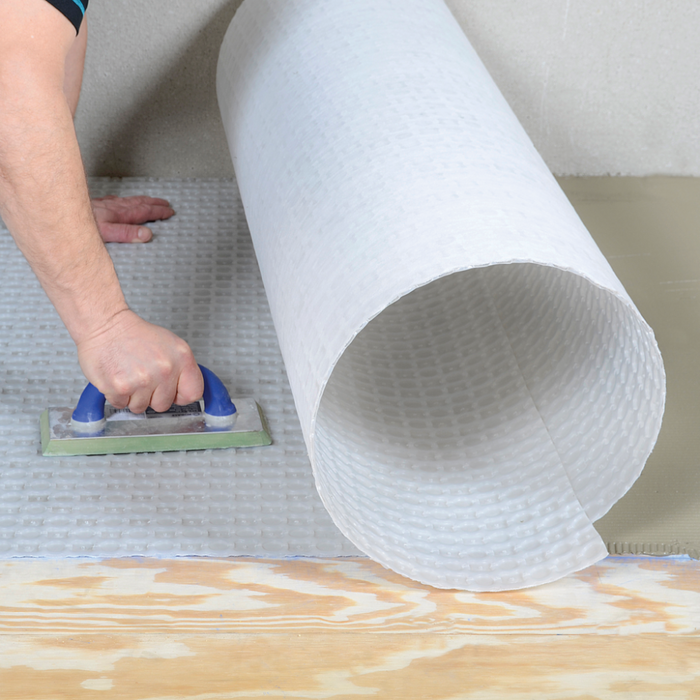 LATICRETE STRATA MAT is a next generation high performance uncoupling membrane provides for an enhanced mechanical bond of the adhesive mortar and provides for faster drying of the mortar, allowing for shorter time to grout.