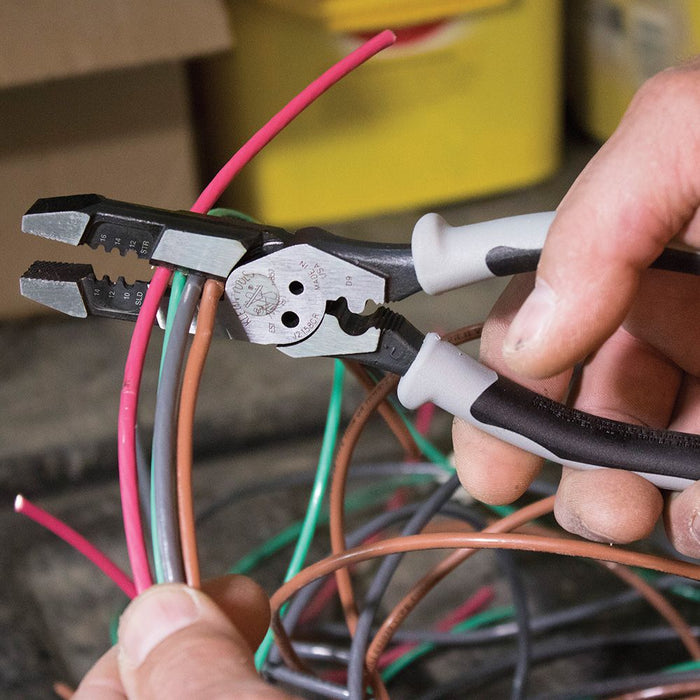 Clipping wire jackets with Klein Tools High-Leverage Hybrid Pliers