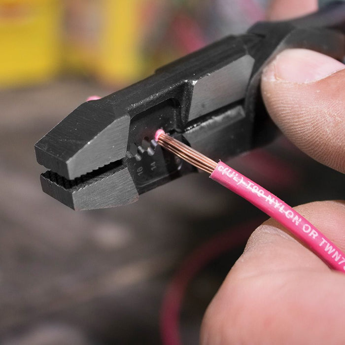 Stripping wire coating with Klein Tools High-Leverage Hybrid Pliers