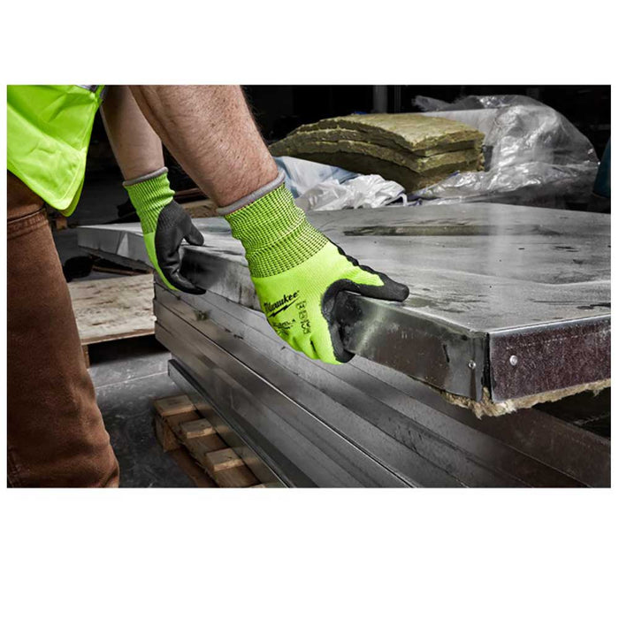 Moving materials with sharp metal edges wearing Milwaukee Cut Level 4 Gloves