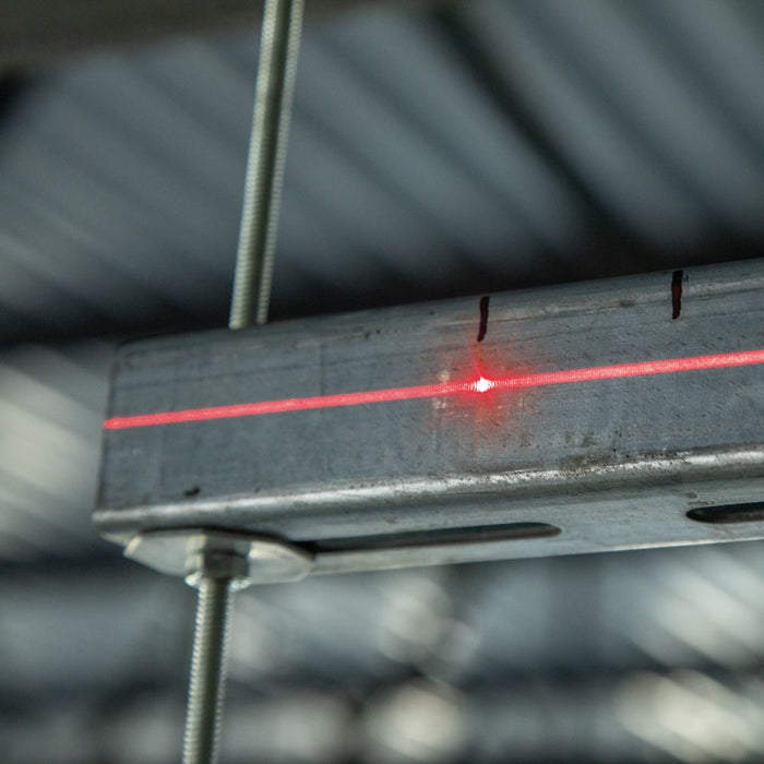 Red laser projected on metal frame