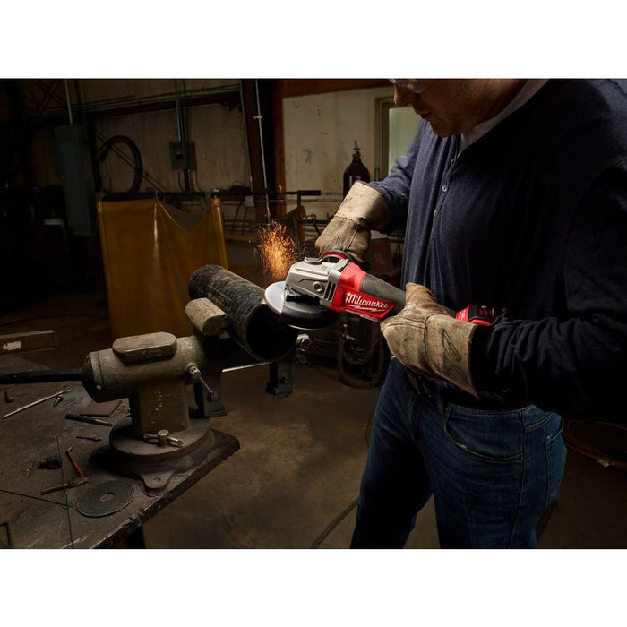 "Grinding metal piece with Milwaukee M18 FUEL™ 5"" Grinder"
