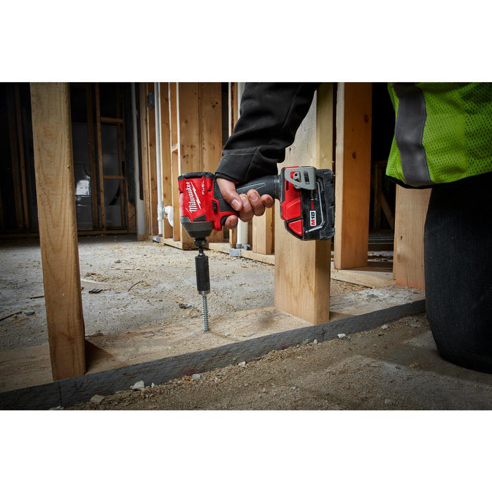 "Milwaukee M18 FUEL™ 1/4"" Hex Impact Driver installing wood frame into concrete floor"