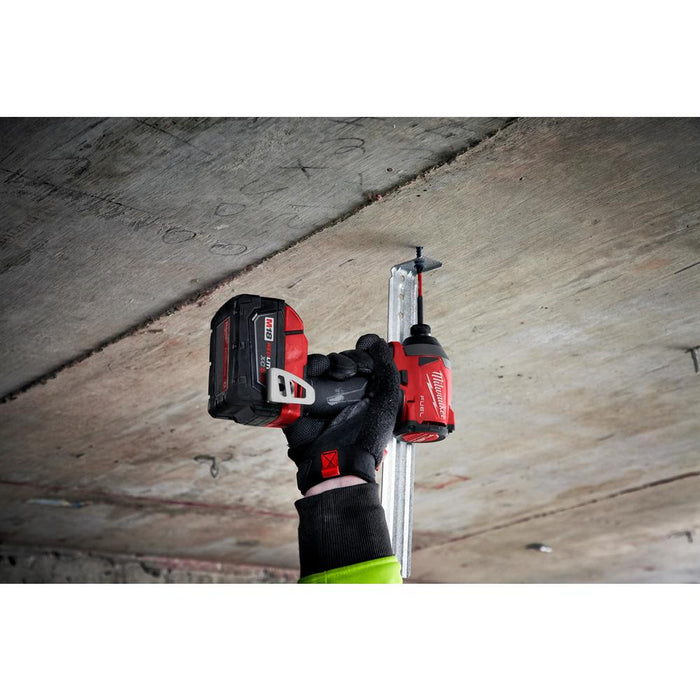 "Milwaukee M18 FUEL™ 1/4"" Hex Impact Driver installing metal frame into concrete ceiling"