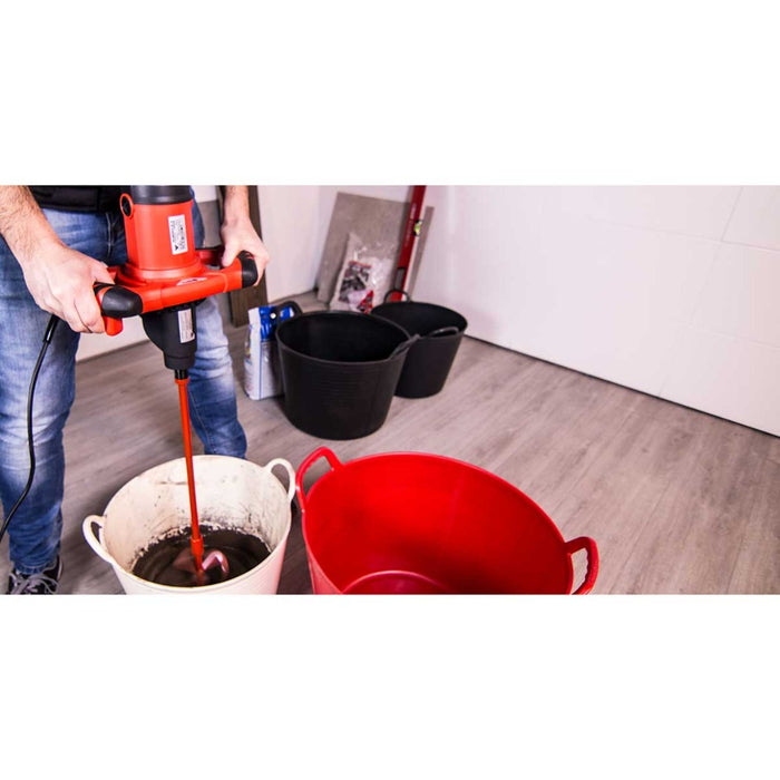 Mixing tile mortar indoor with RubiMix 9N and rubber buckets