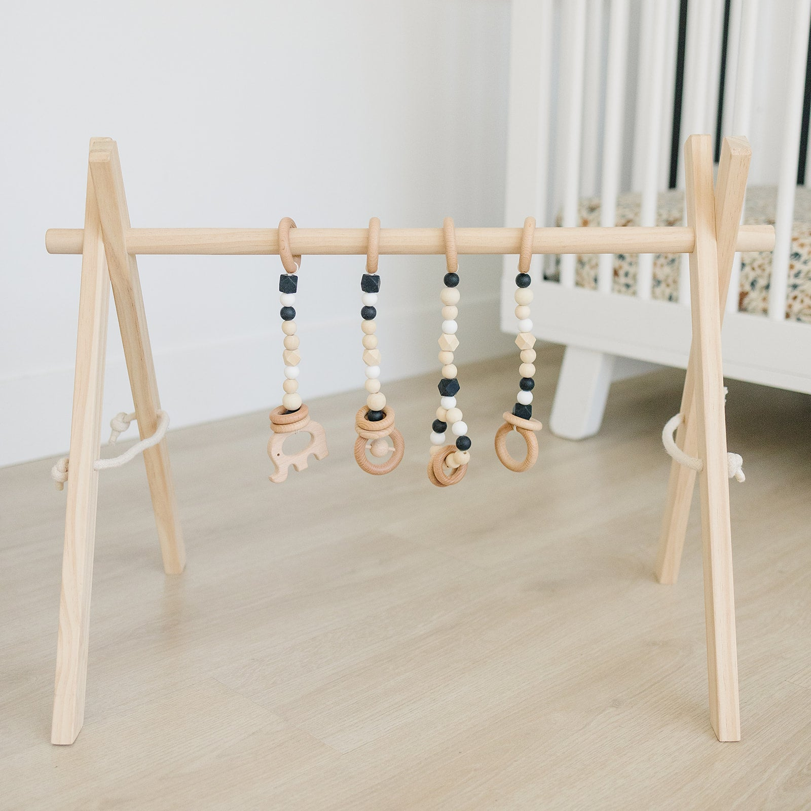 Wooden Baby Gym + Black Toys BABYLIST
