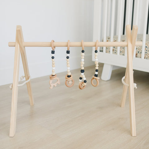 Wooden Baby Gym + Black Toys
